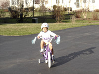 Isabelle'riding'her'Princess'Bike